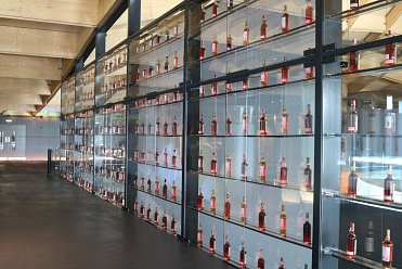 Large glass display area for whiskey bottles
